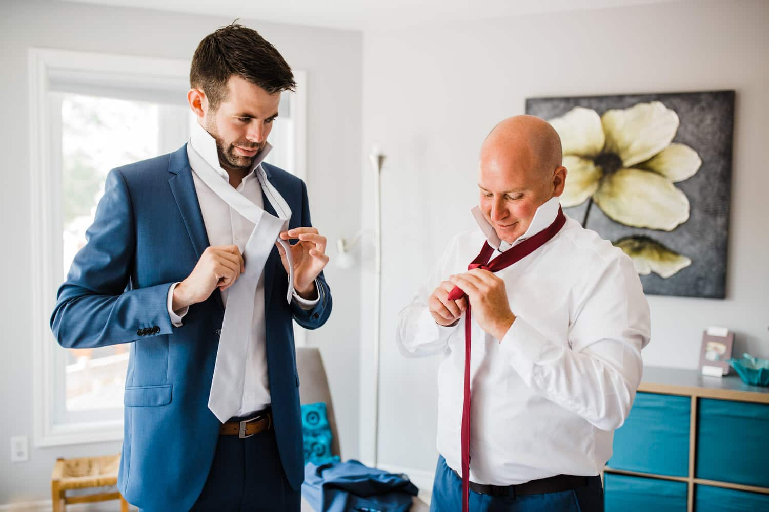 man helps groom with his tie - groom prep