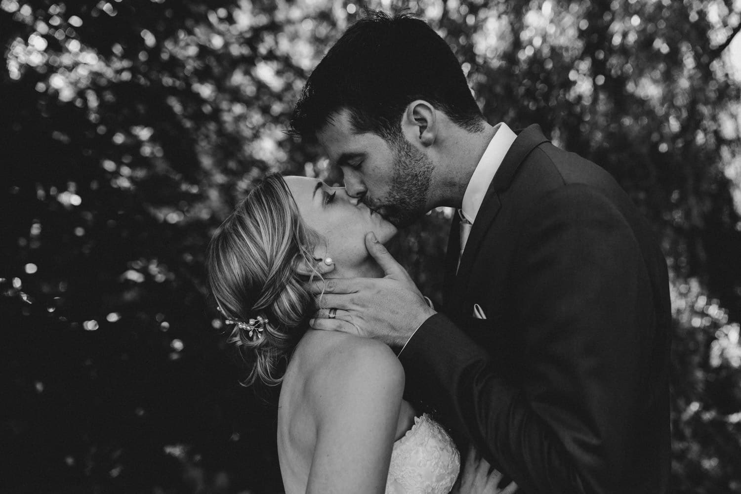 black and white photo of bride and groom kissing - glebe community centre wedding