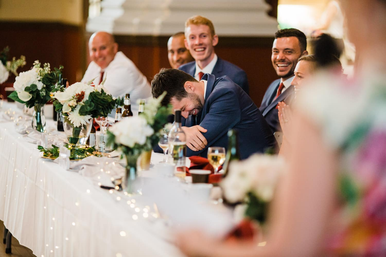 groom laughs during wedding speeches - glebe community centre wedding