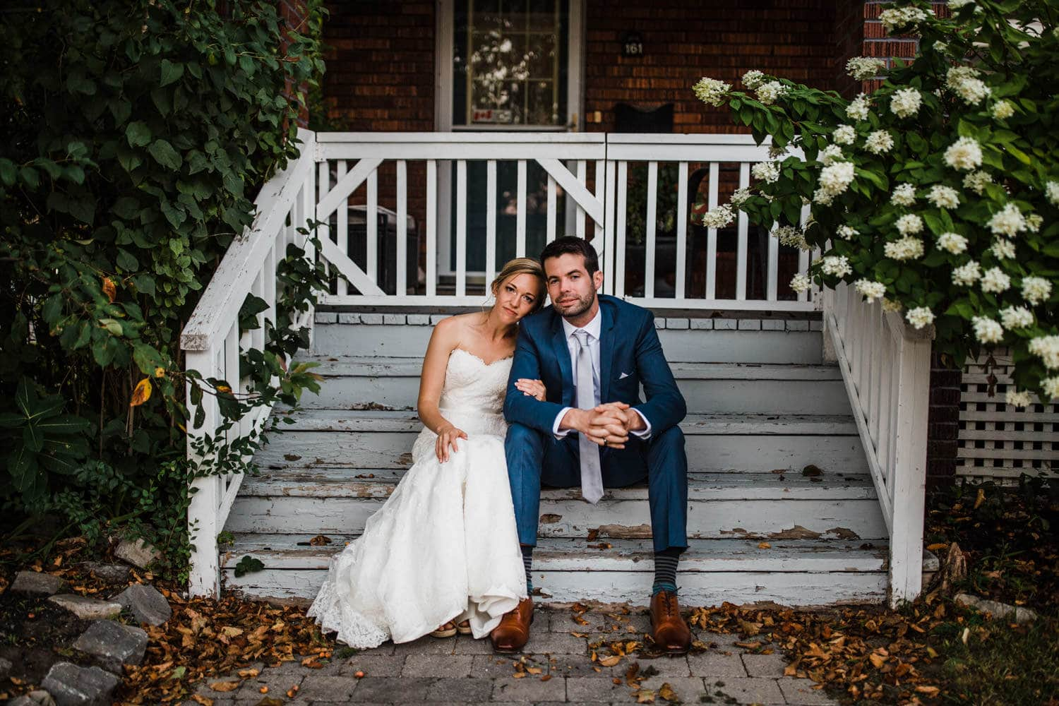 couple sit on front porch - glebe community centre wedding
