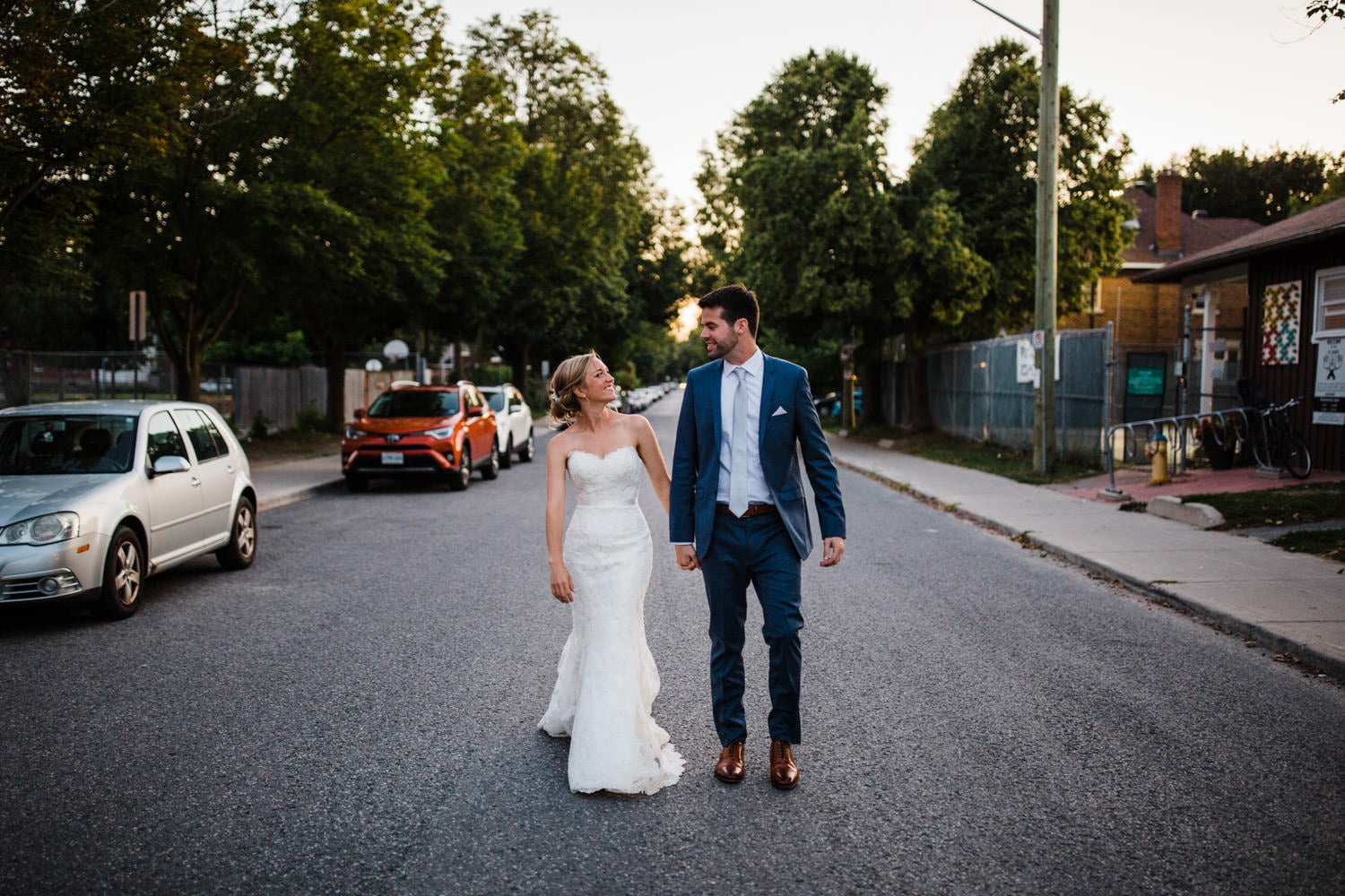 couple walk down street together - glebe community centre wedding
