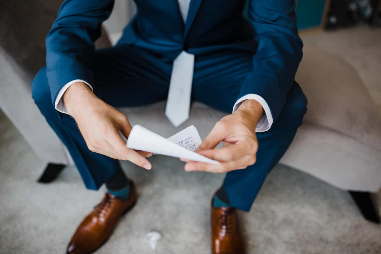 groom reads letter from bride morning of wedding