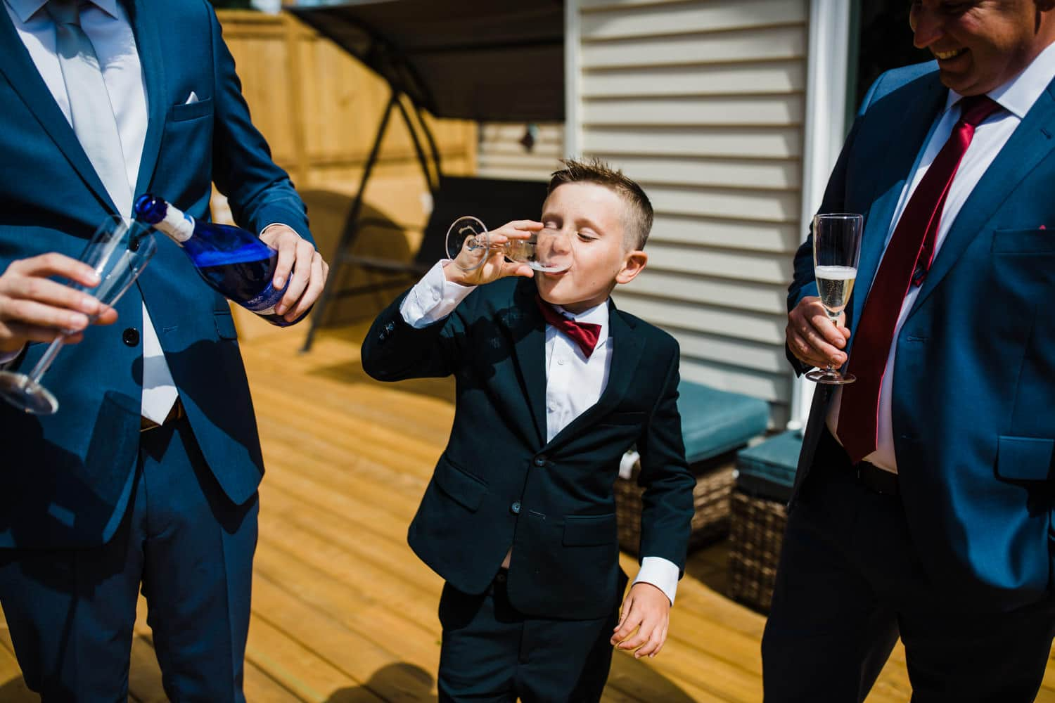 ring bearer chugs champagne - ottawa wedding photographer