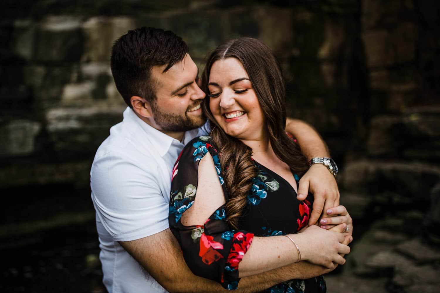 man wraps his arms around woman during engagement session - princess louise falls engagement