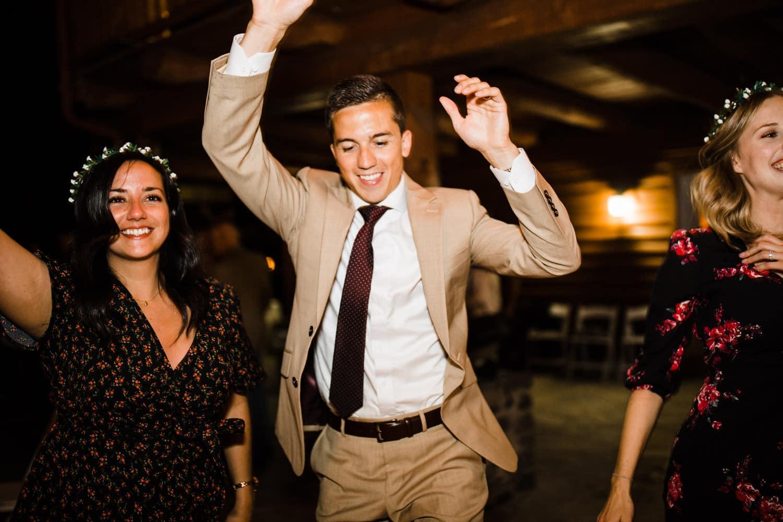 groom dances on outdoor dance floor