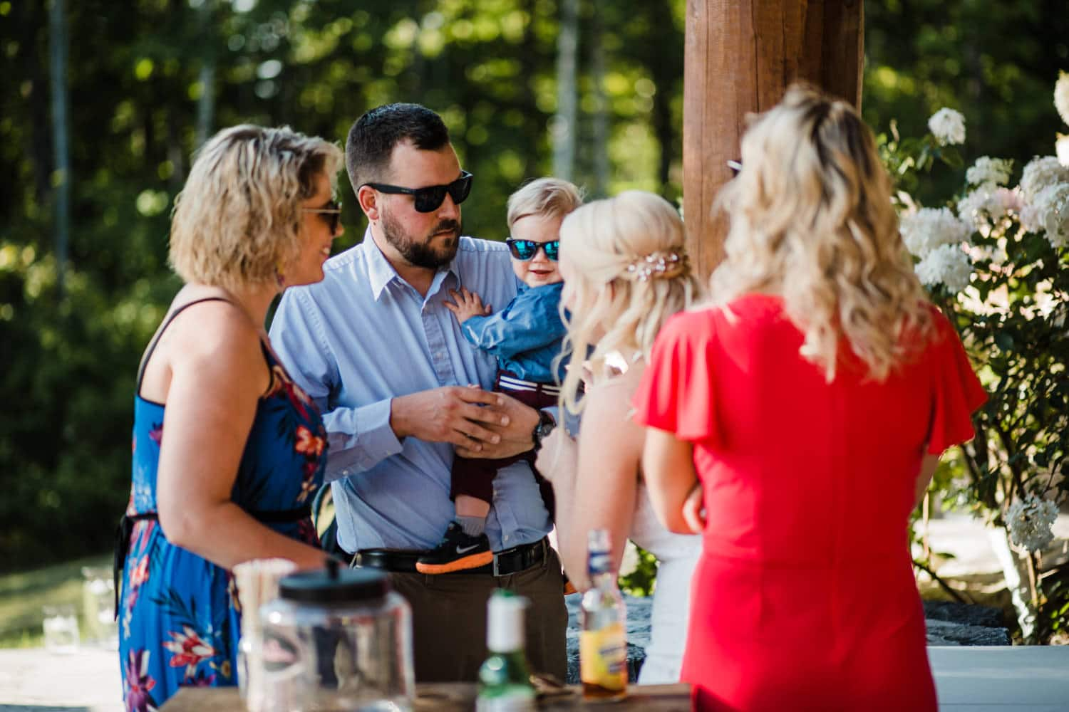 bride greets her guests on outdoor stone patio