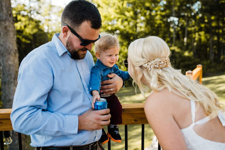 bride greets her nephew on outdoor patio