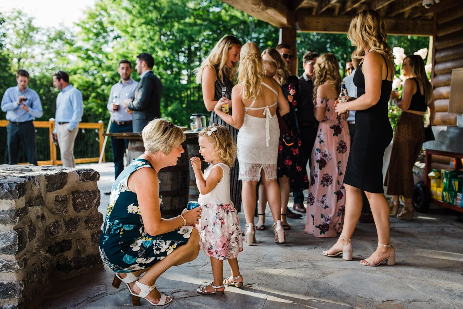 guests mingle on stone patio at outdoor wedding