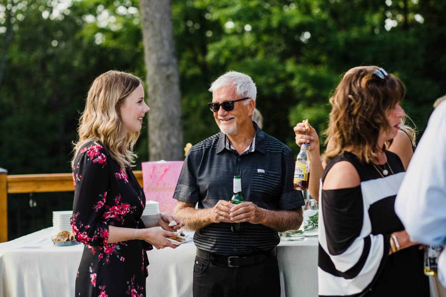 guests mingle at outdoor surprise wedding