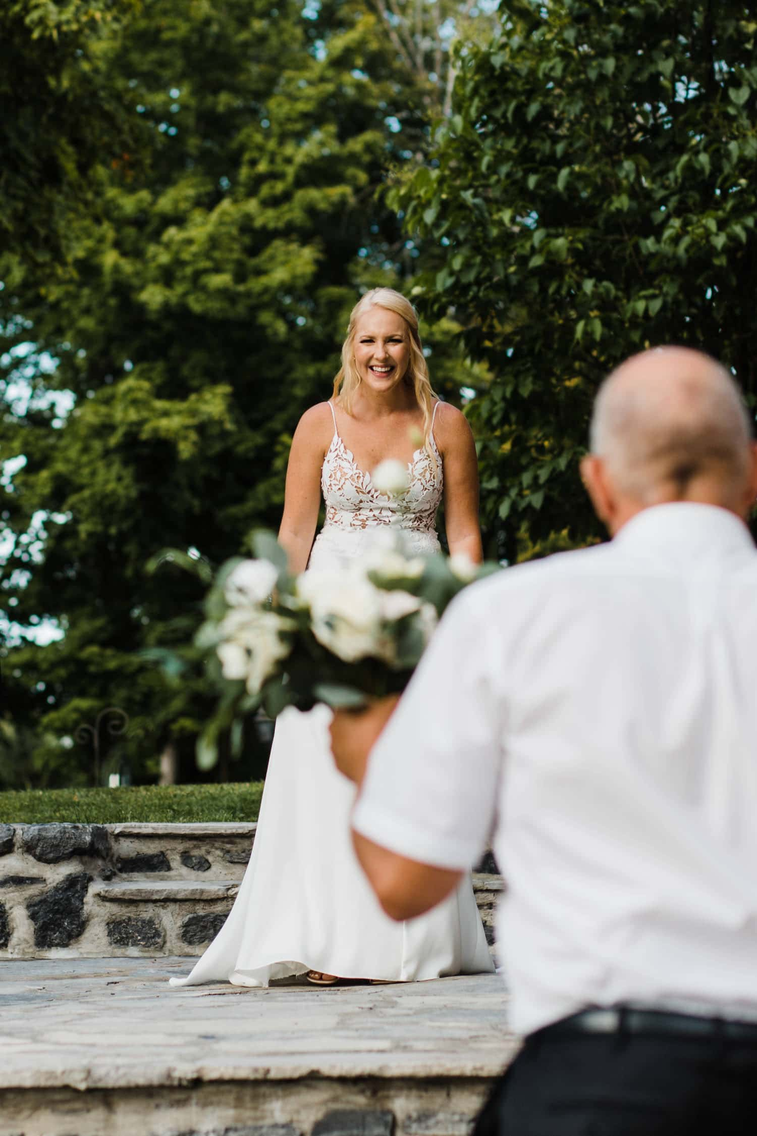 bride's father sees her at outdoor surprise wedding