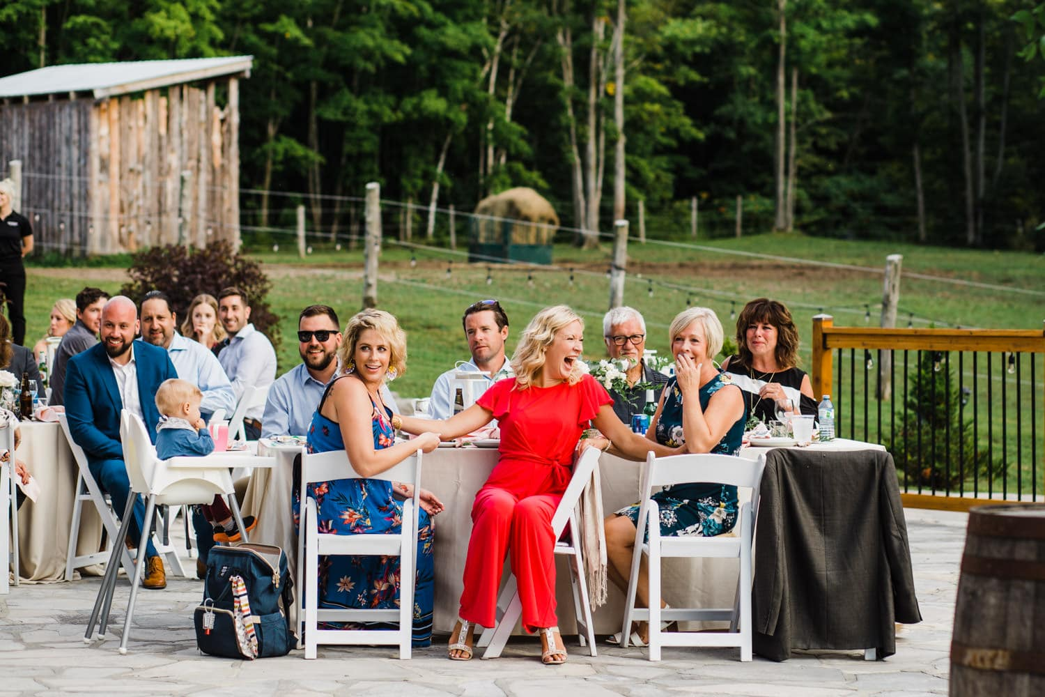 guests react to seeing bride at outdoor surprise wedding - ottawa wedding photographer