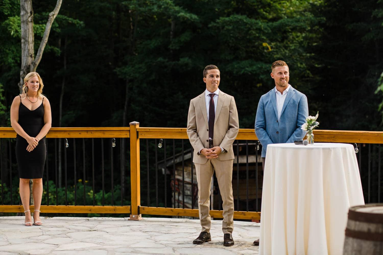 groom sees his bride during outdoor surprise wedding