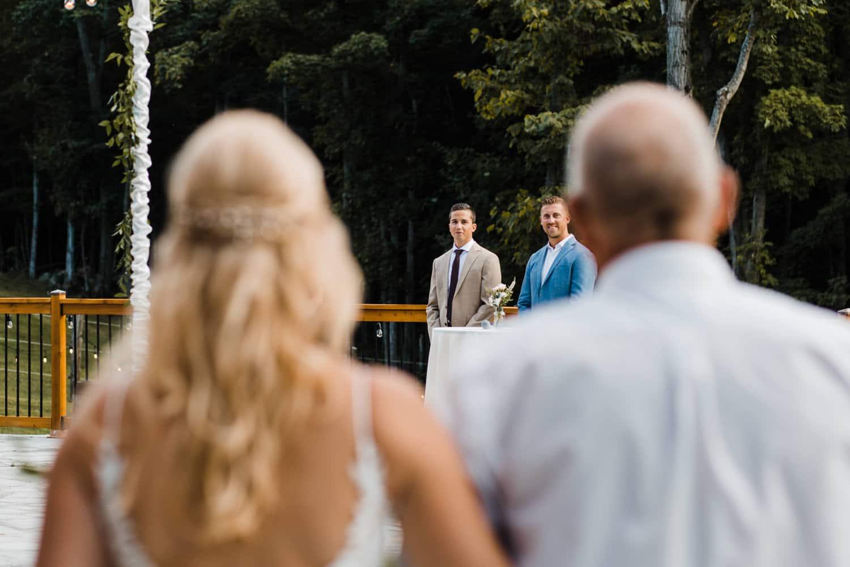 groom sees his bride at outdoor surprise wedding
