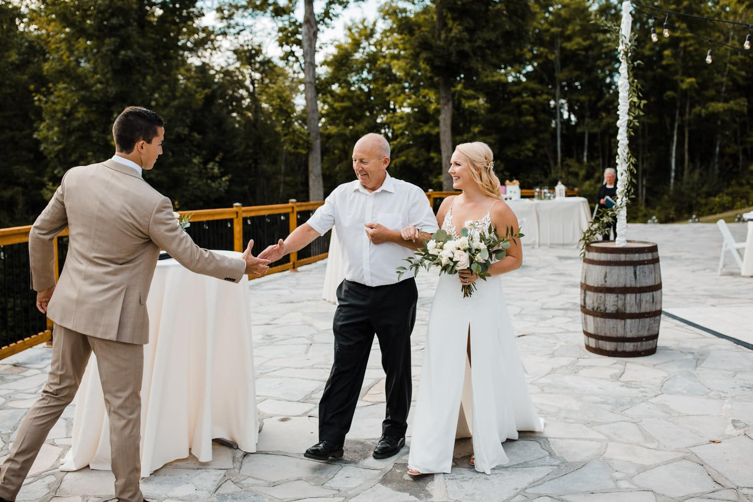 bride and father walk down aisle at outdoor surprise wedding