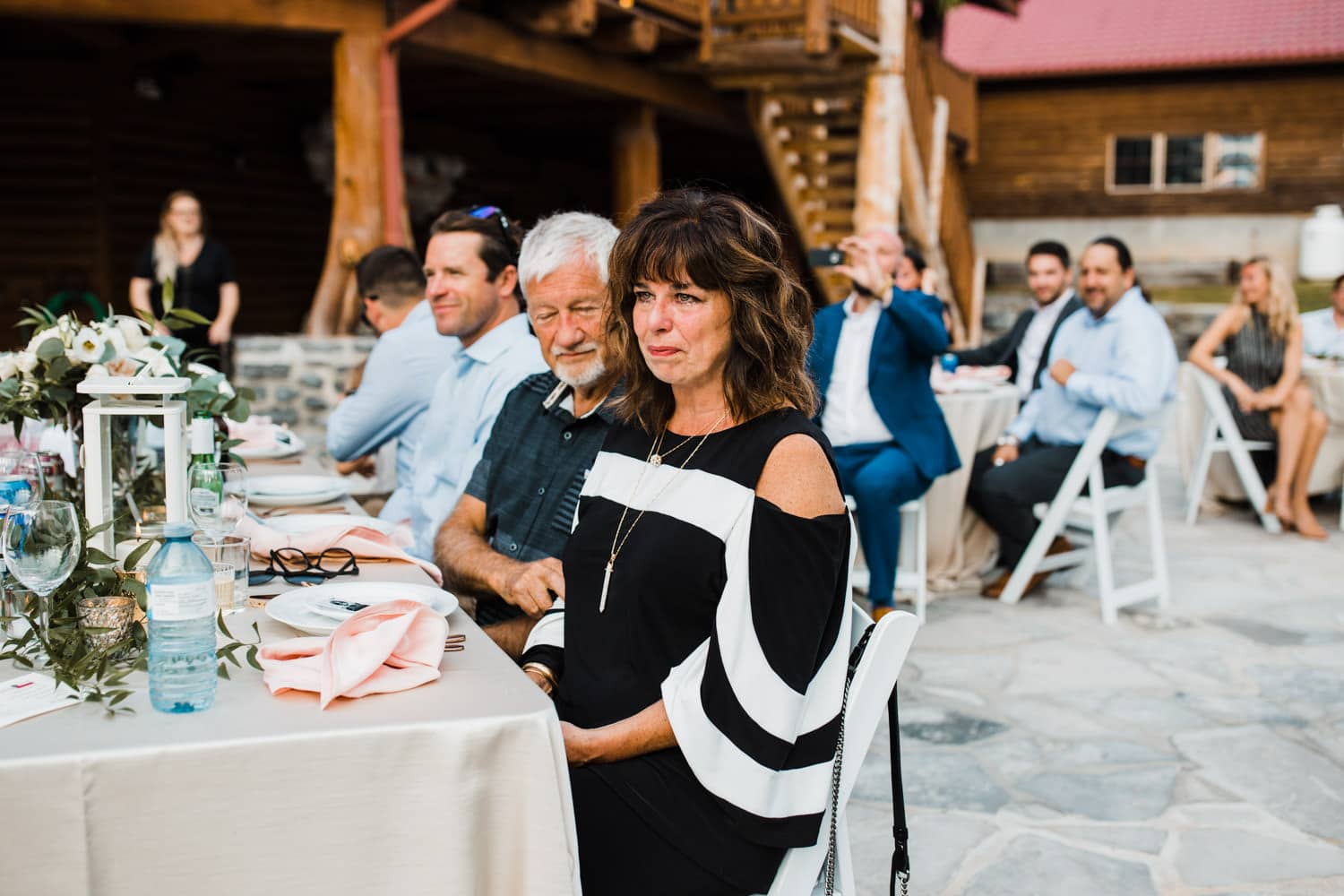 mother of the groom cries during outdoor surprise wedding
