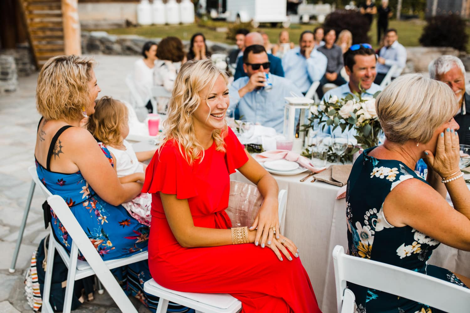 guests react to outdoor surprise wedding