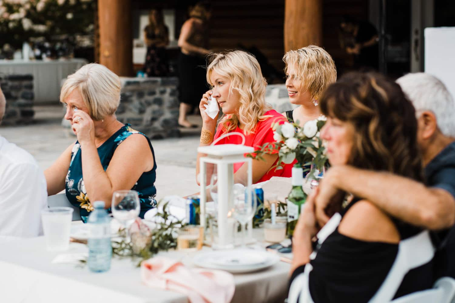 guests cry during outdoor surprise wedding