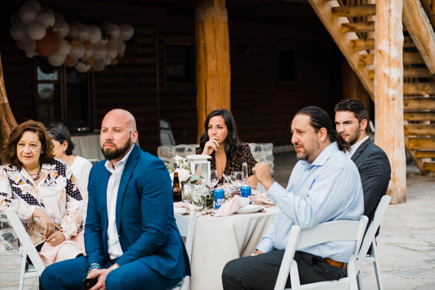 guests watch closely during outdoor wedding