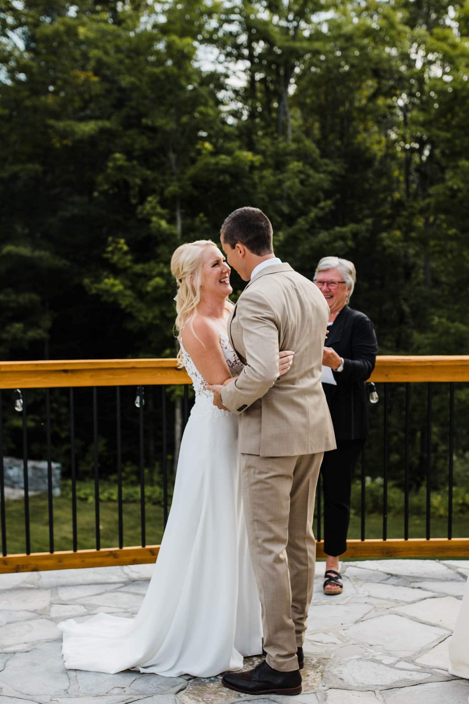bride and groom kiss during outdoor wedding - ottawa wedding photographer