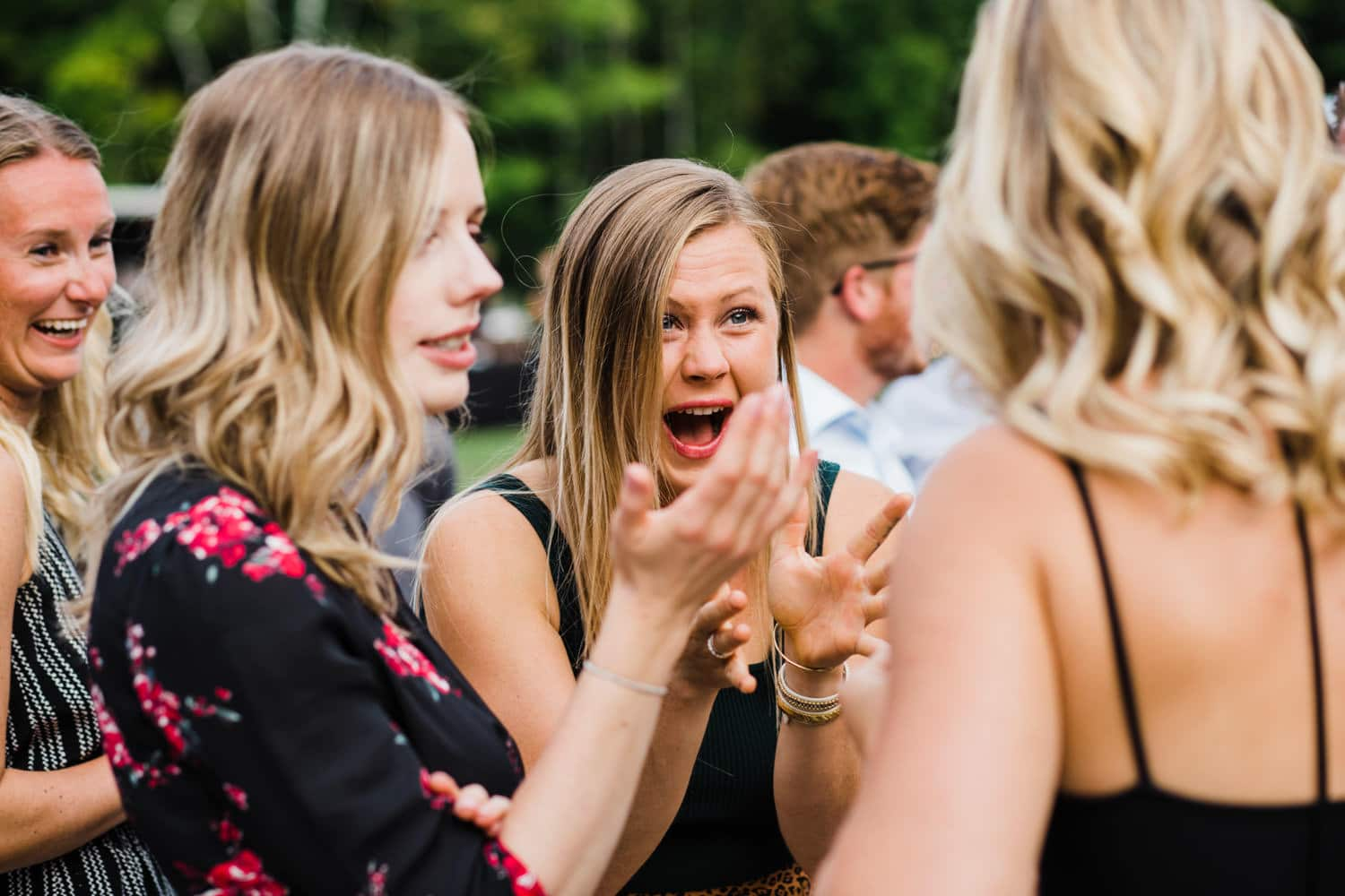 guests react after outdoor surprise wedding ceremony