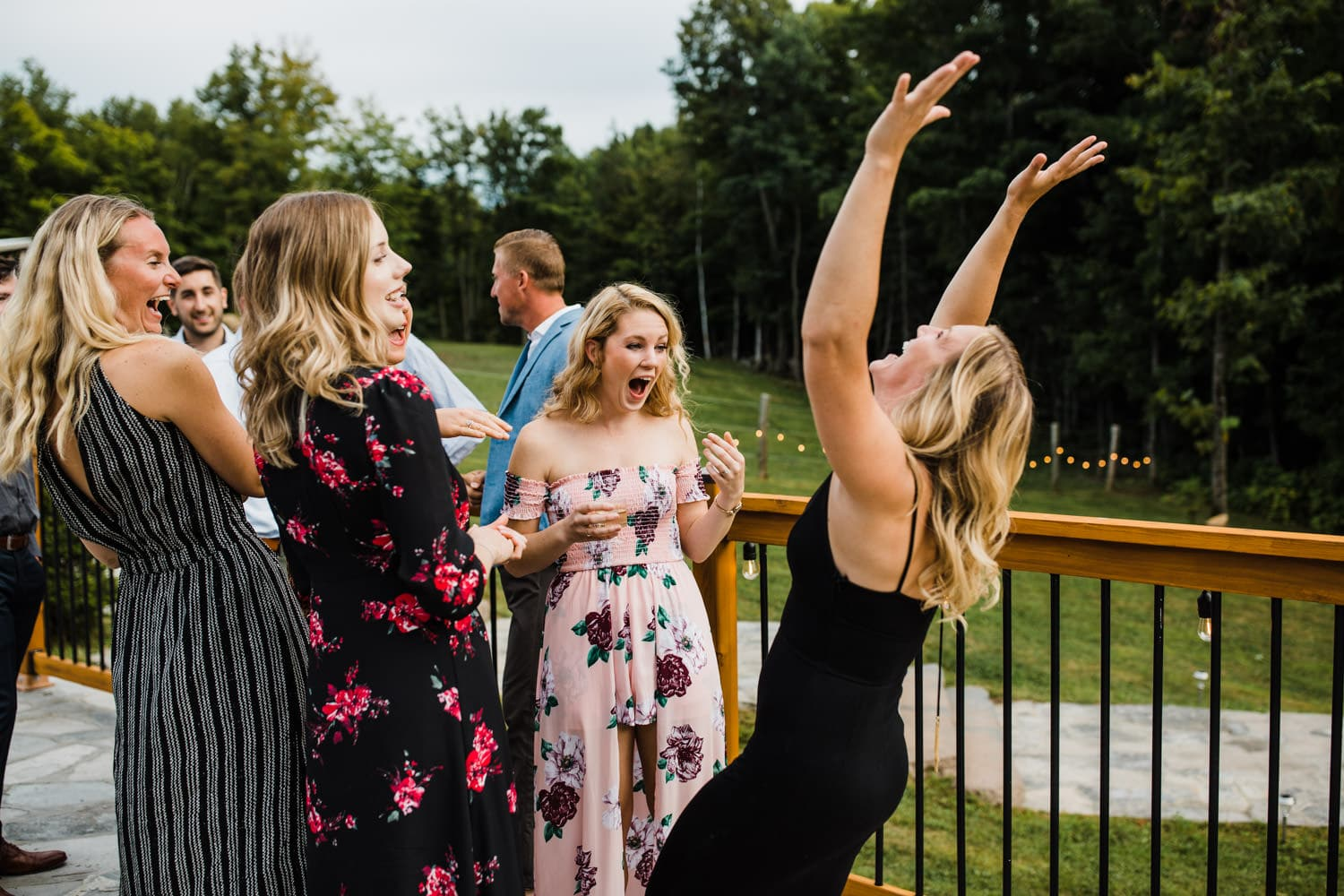 guests react after outdoor surprise wedding ceremony - ottawa wedding photographer