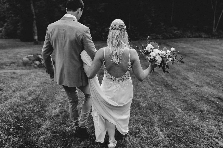 bride and groom walk together outside after surprise wedding ceremony