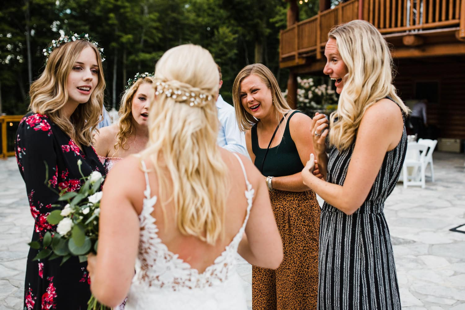 friends look shocked and surprised after outdoor wedding ceremony