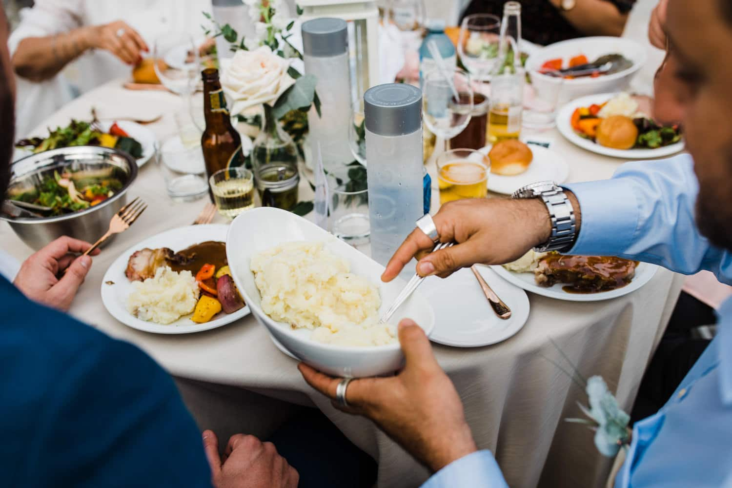 family style dinner at outdoor wedding