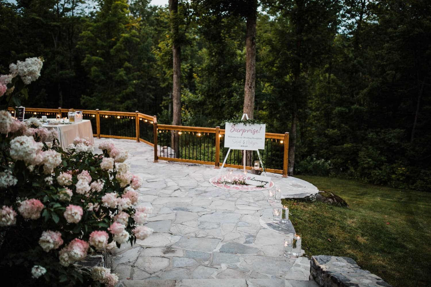 welcome area at outdoor wedding on stone patio