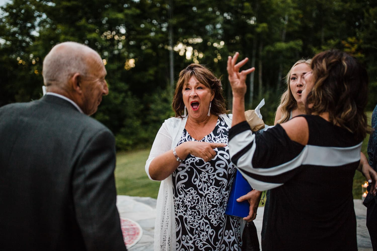 guests react after arriving at as surprise wedding reception