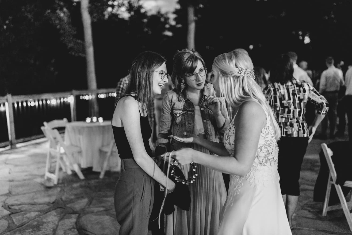 bride chats with guests at outdoor wedding reception