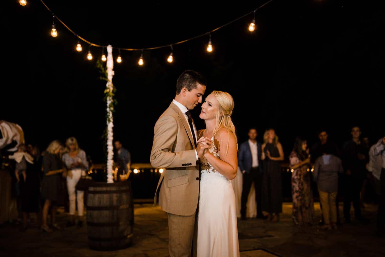 bride and groom first dance under twinkle lights - ottawa wedding photographer