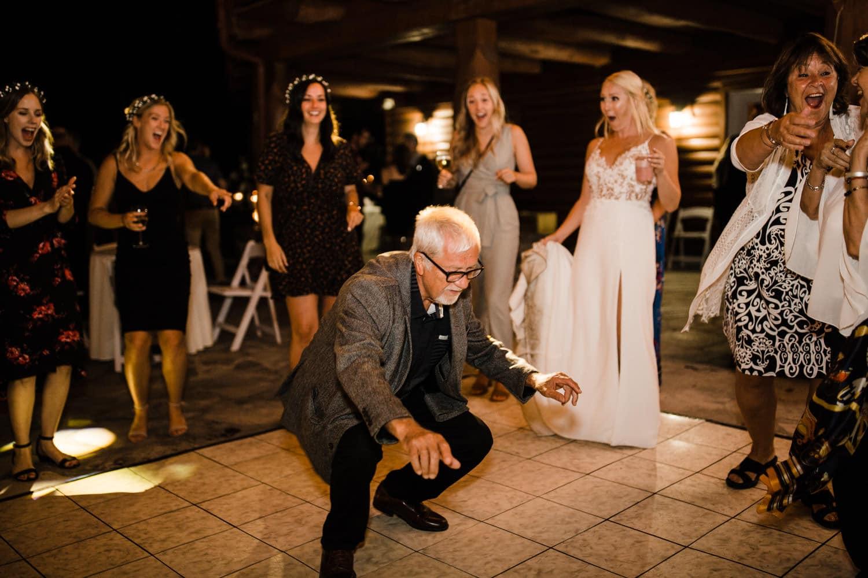 guests dance on outdoor dance floor at wedding
