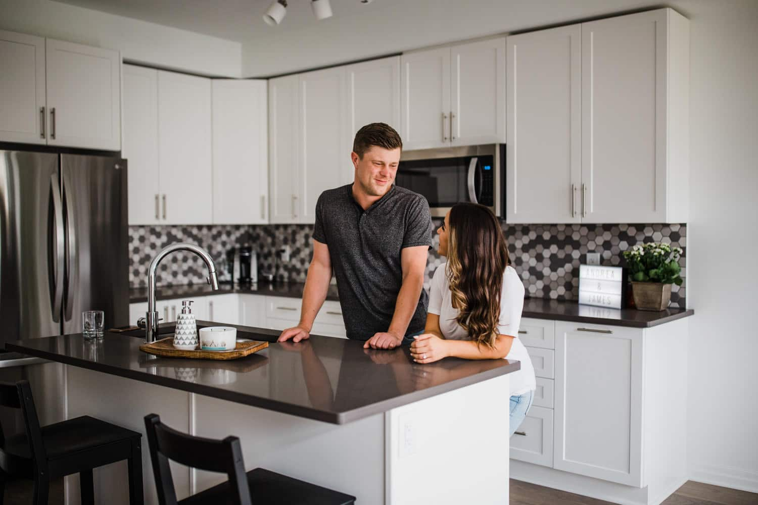 couple hang out by kitchen island