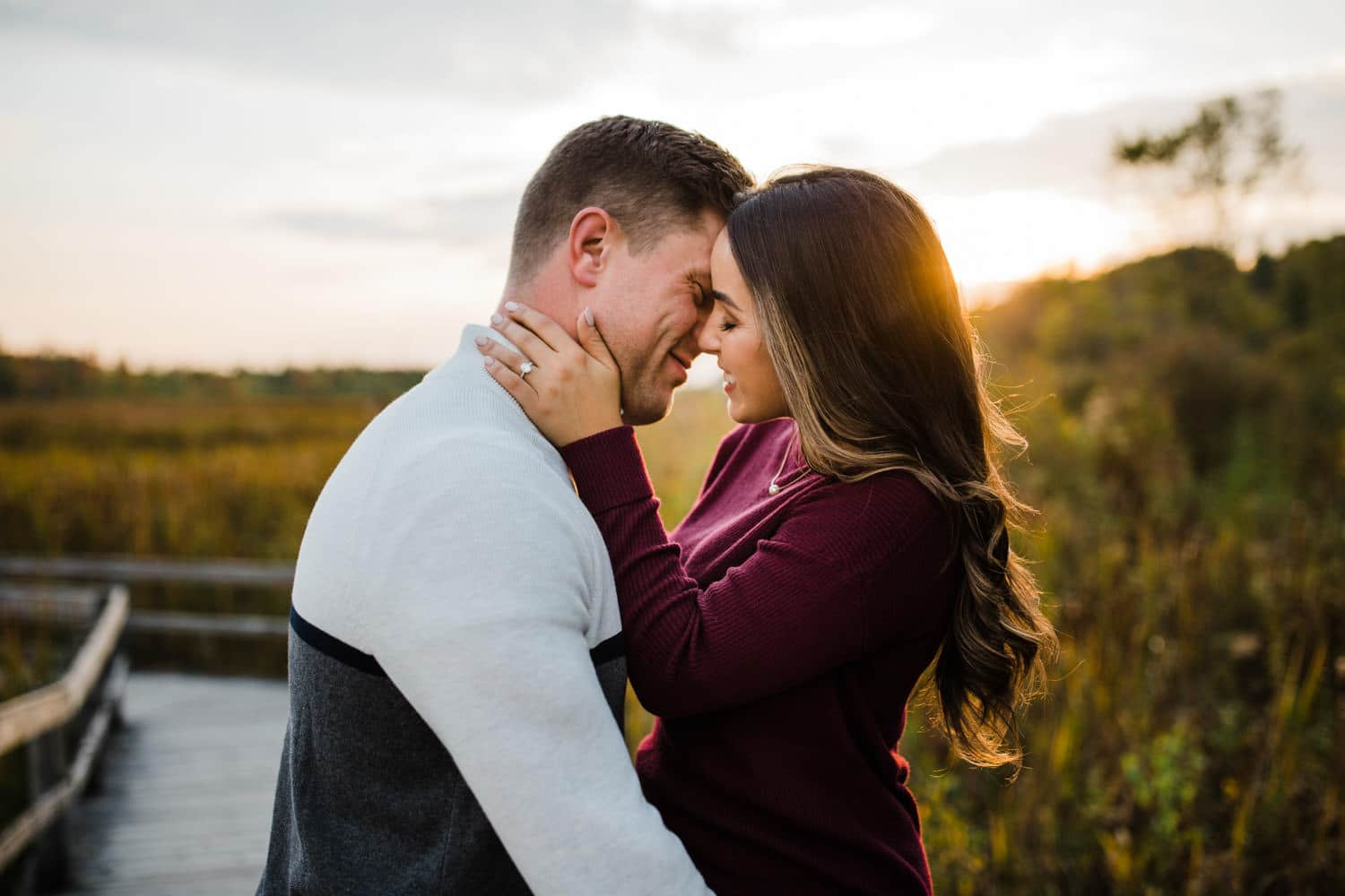 engaged couple almost kiss during golden hour - ottawa engagement session