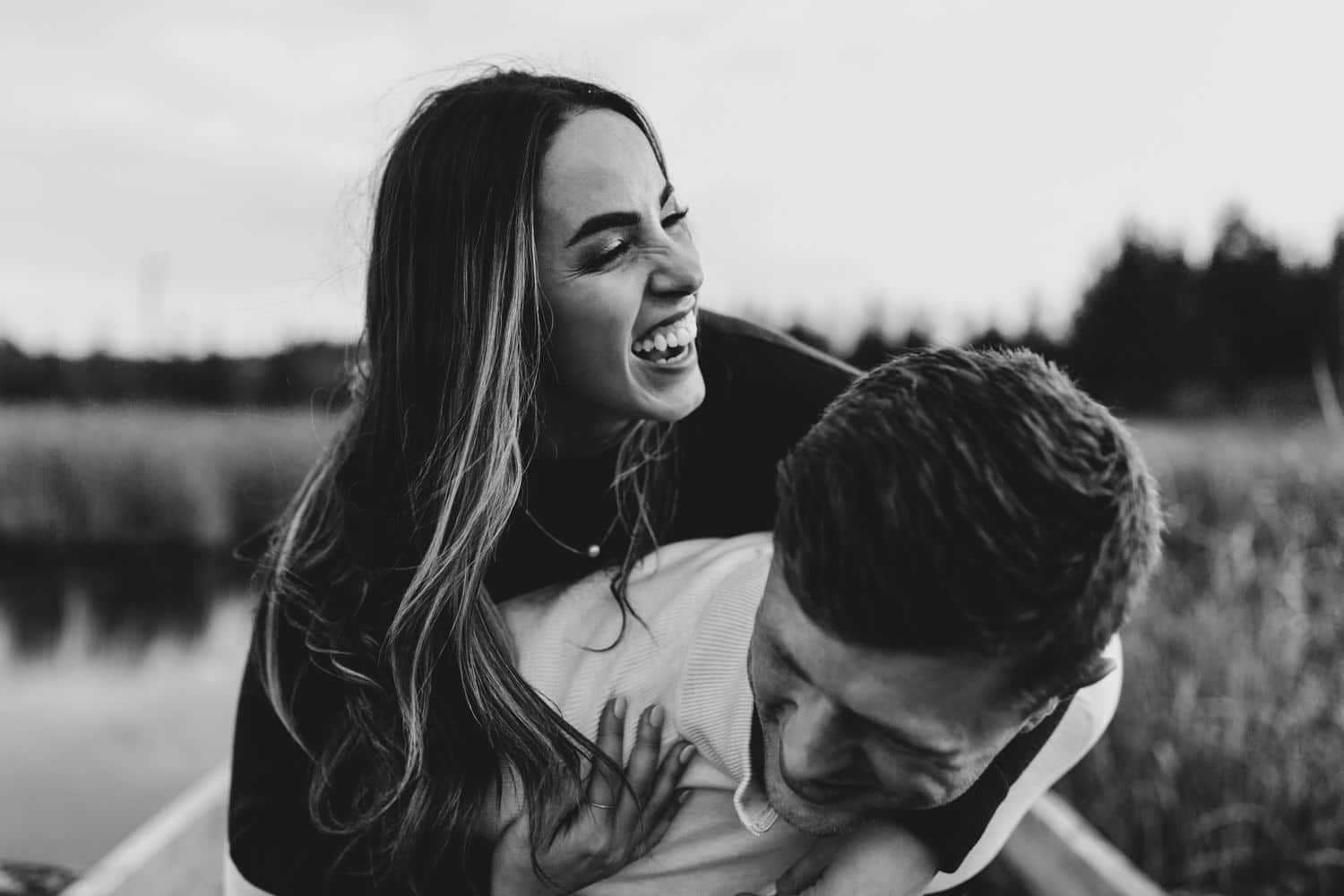 woman laughs during piggy back ride - ottawa fall engagement