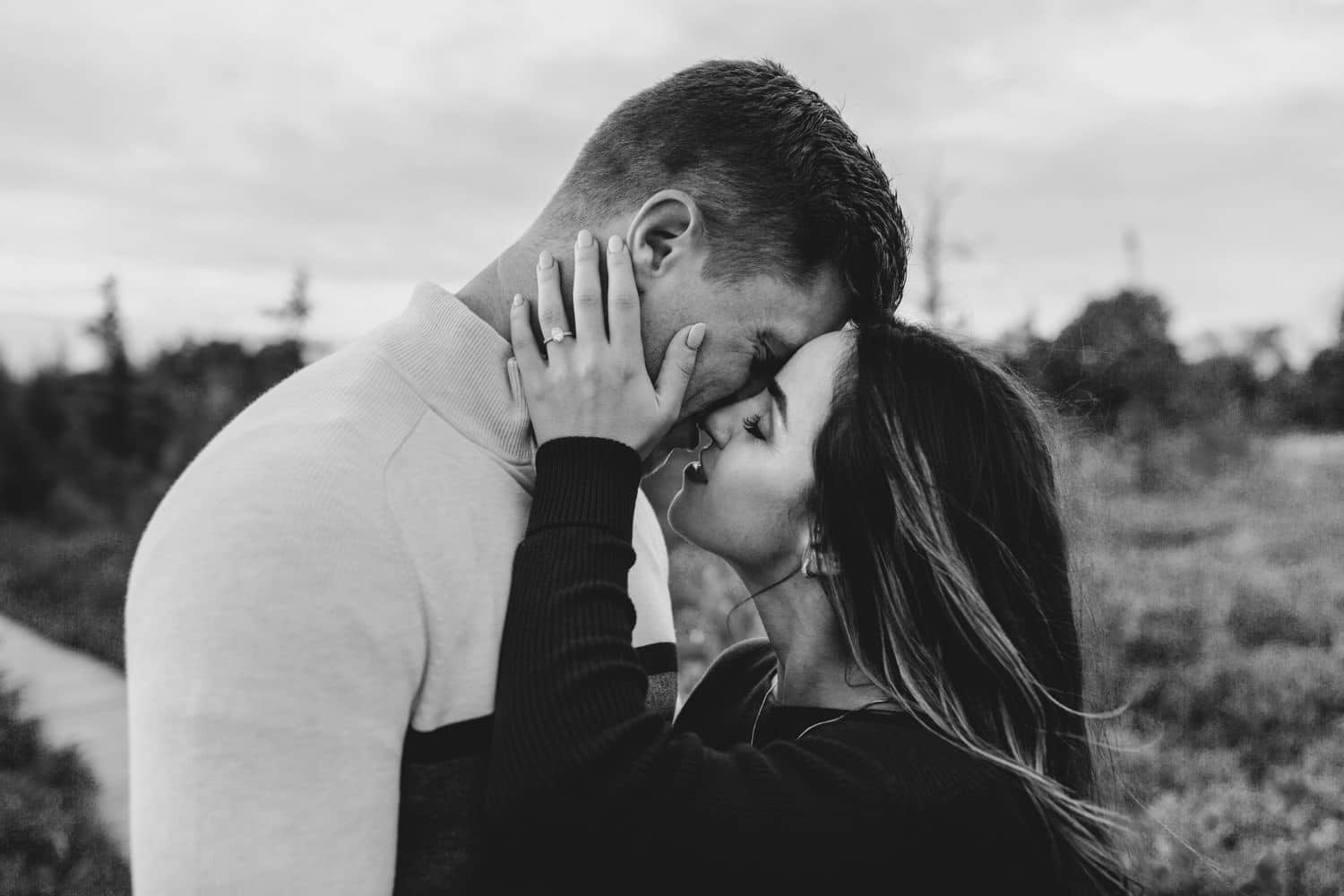 couple lean in for kiss - ottawa fall engagement