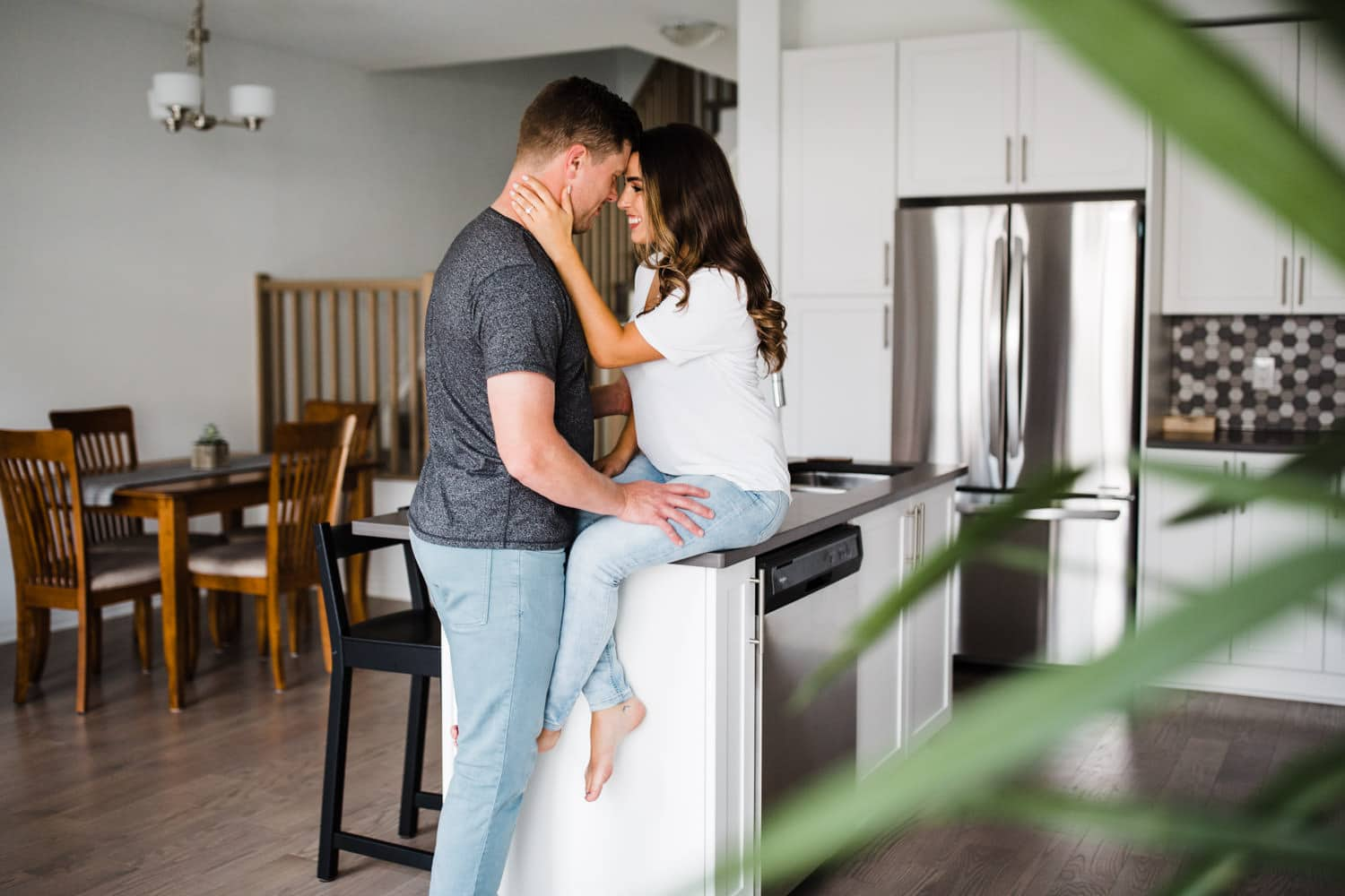 couple hang out by kitchen island together - ottawa in home engagement