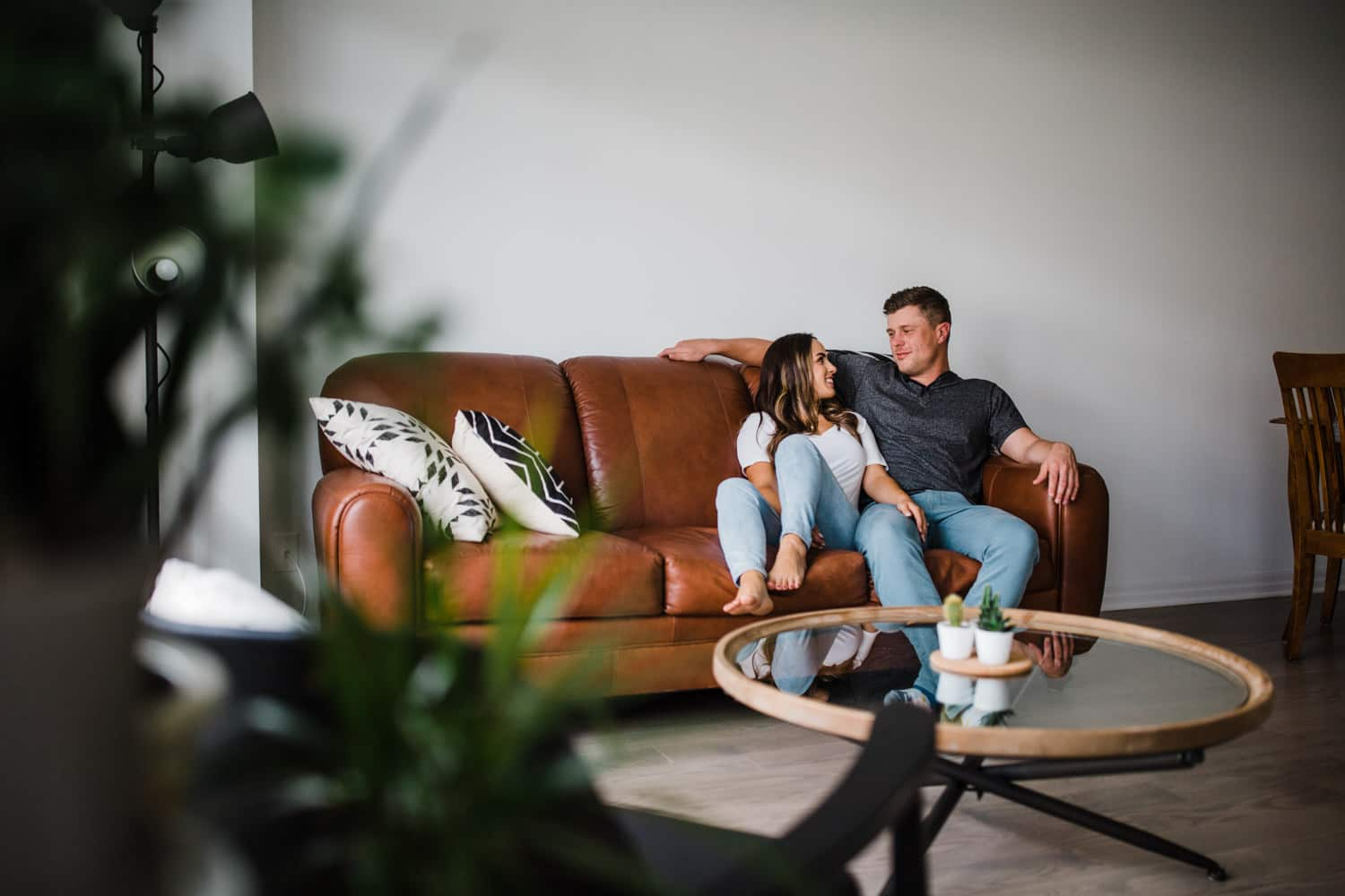 couple hang out on living room sofa together - ottawa in home engagement