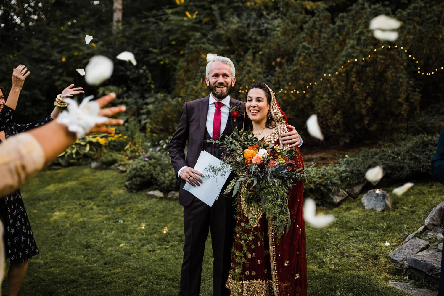 guests throw rose petals at bride and groom - rockcliffe park intimate ceremony