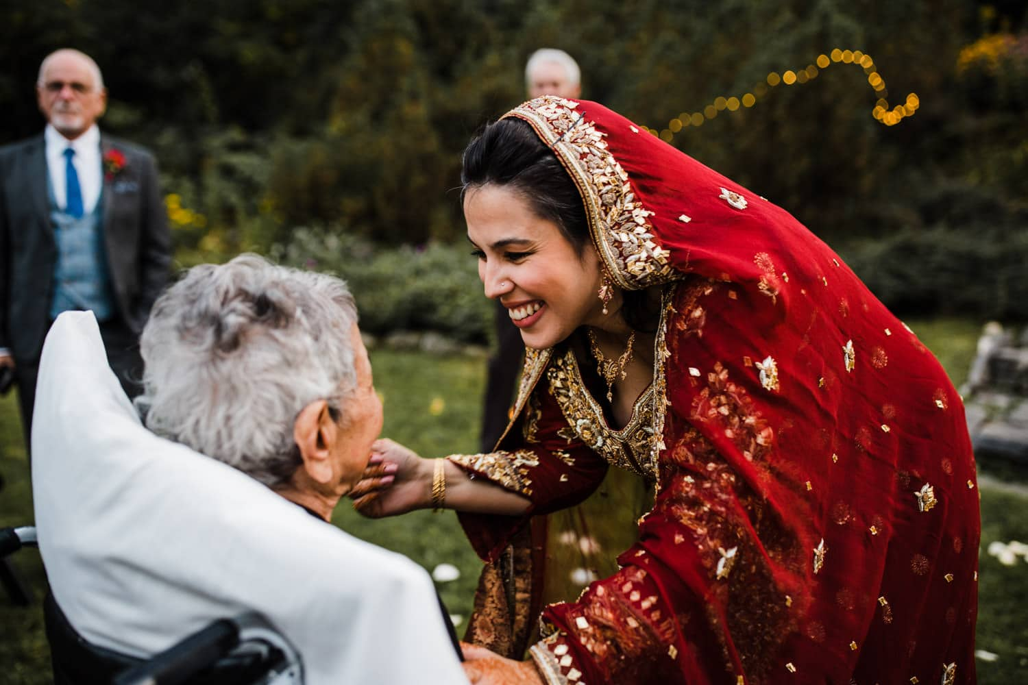 bride talks with her grandmother after outdoor intimate ceremony