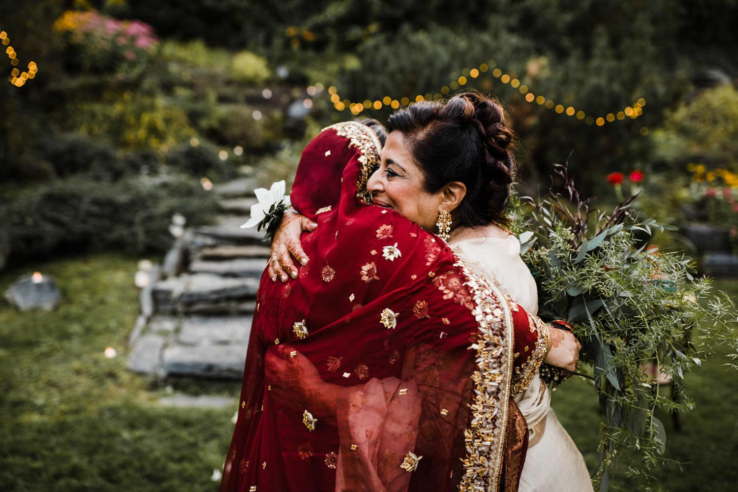 bride hugs her mother after rockcliffe park intimate ceremony