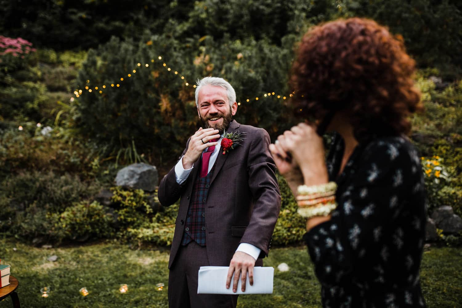 groom laughs with his sister - outdoor intimate wedding - rockcliffe park
