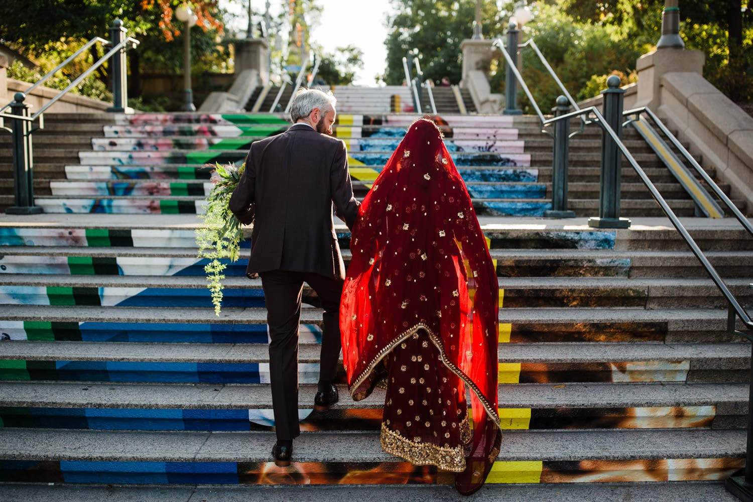 couple walk up stairs together outside - ottawa elopement