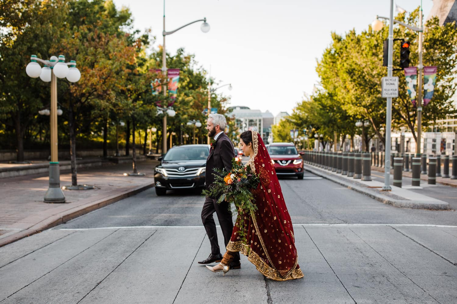 couple walk through downtown streets together - ottawa elopement