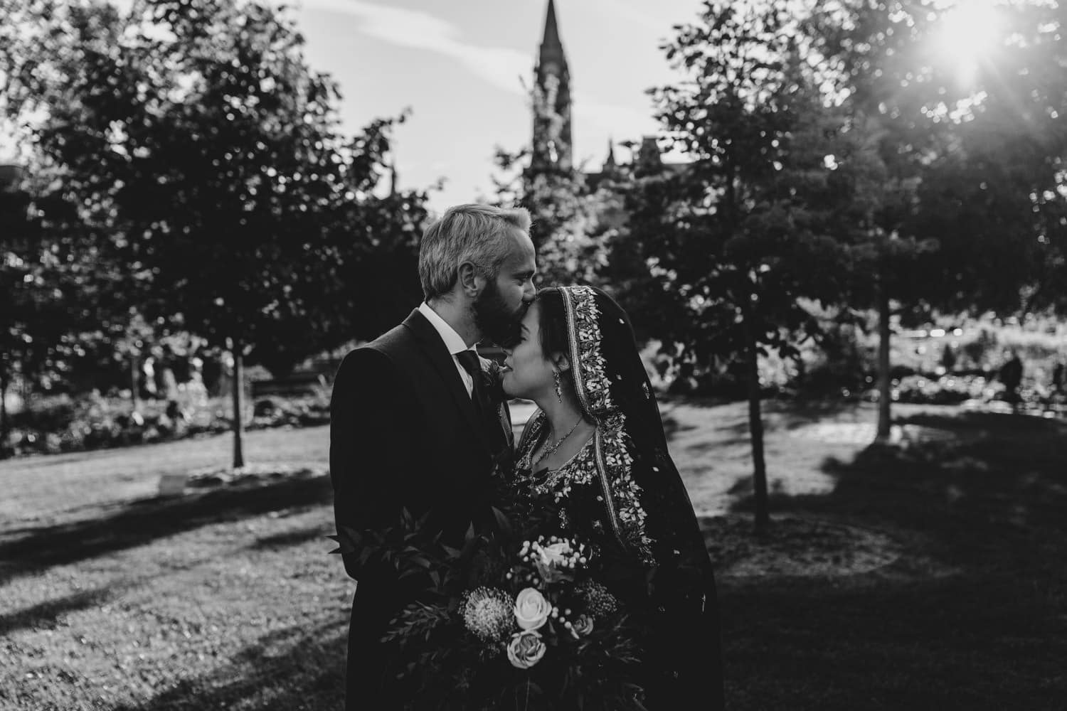 groom kisses bride's forehead - ottawa elopement