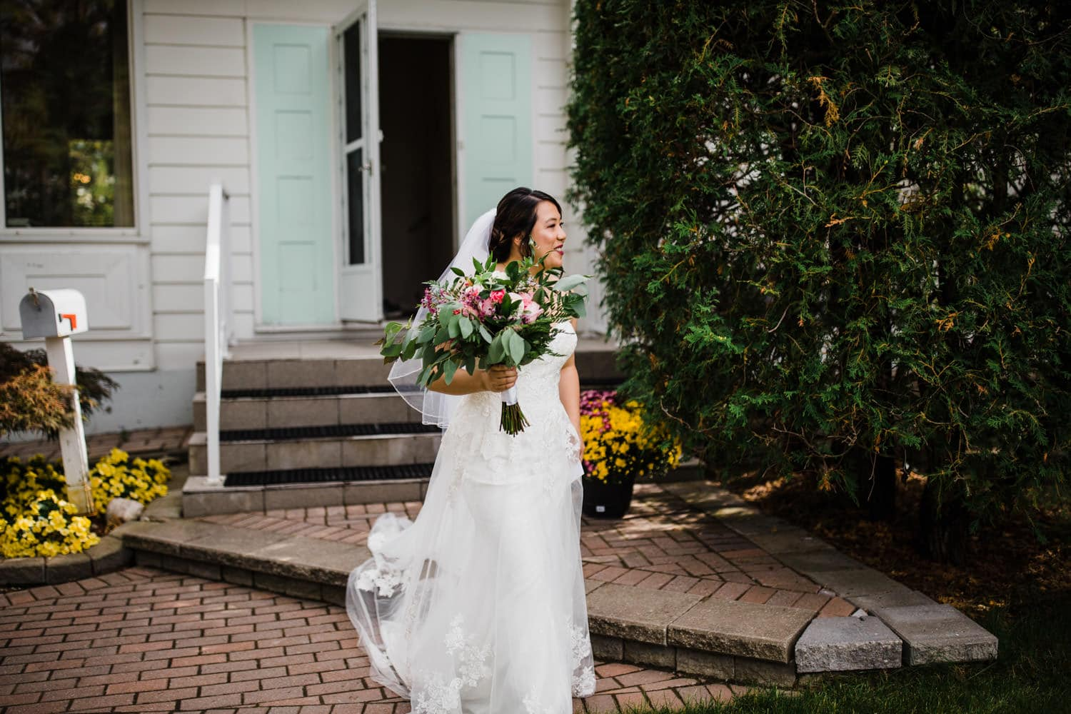 bride walks out of childhood home for first look - small ottawa backyard wedding