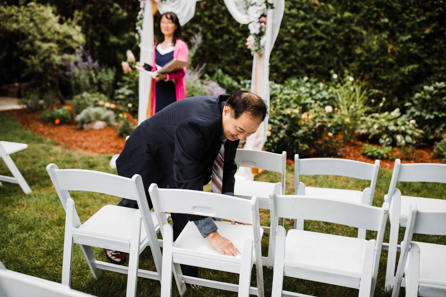 guests dry off chairs after rain - backyard wedding ottawa