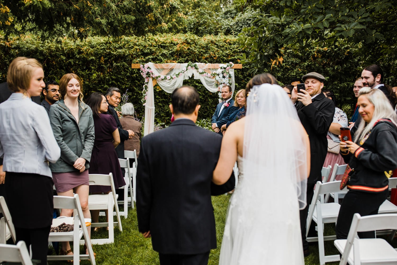 bride walks down aisle - small backyard wedding ottawa