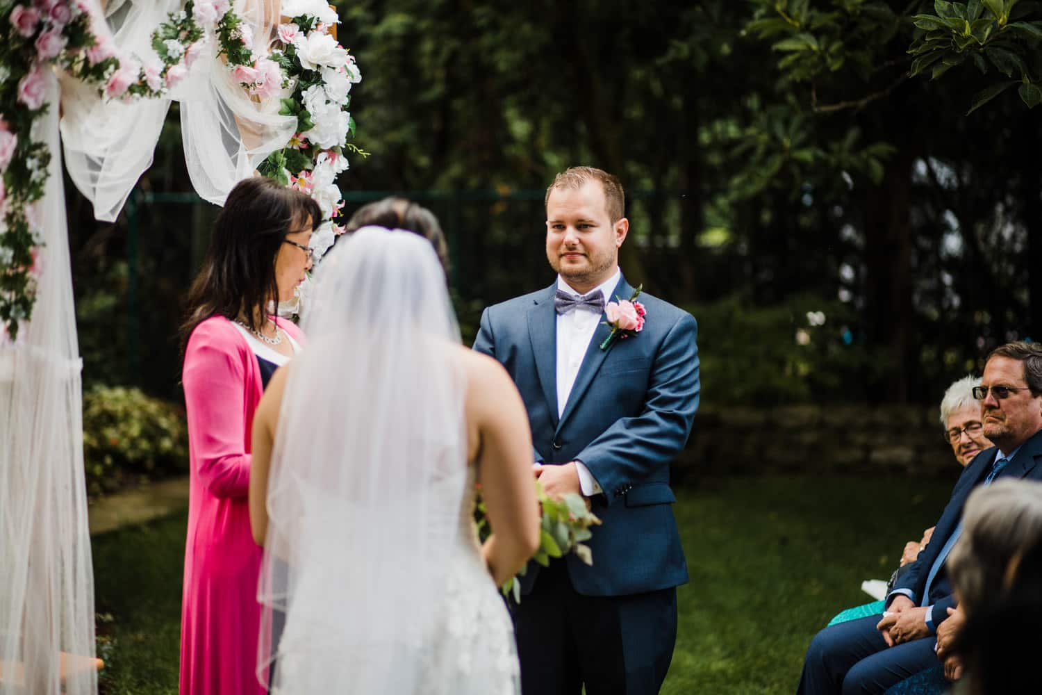 bride and groom recite vows - small ottawa backyard wedding